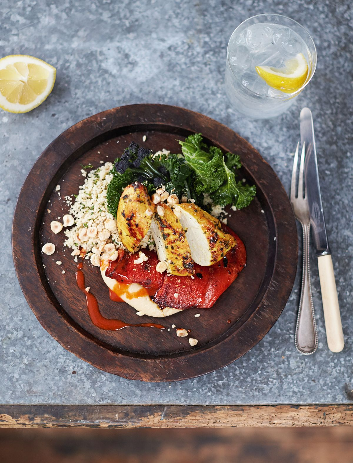Seared Turmeric Chicken Houmous, Peppers, Couscous and Greens